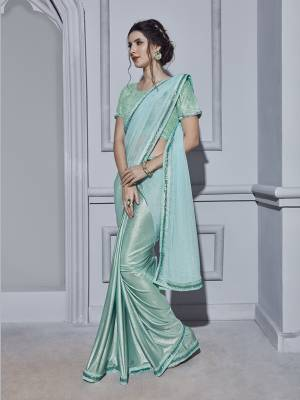 Here Is A Very Pretty Shade With This Ready To Wear Saree In Aqua Blue Color Paired With Aqua Blue Colored Blouse. This Saree And Blouse Are Fabricated On Fancy Fabric Beautified With Attractive Pearls Over The Blouse.