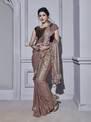 Look Pretty Wearing This Designer Ready To Wear Saree In Dusty Pink Color Paired With Dark Wine Colored Blouse. This Saree And Blouse Are Fabricated On Fancy Fabric Beautified Pretty Hand Work Making It More Attractive. Buy this Designer Saree Now.