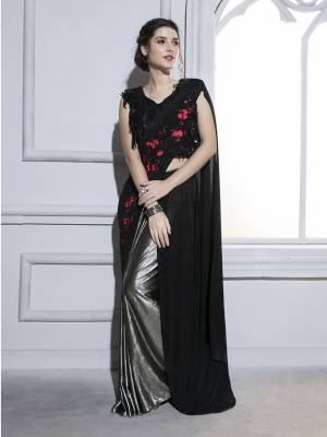 Deck Up With all That Jazz Wearing This Designer Ready To Wear Saree In Black And Silver Paired With Black Colored Blouse. This Saree And Blouse Are Fancy Fabric Based Which Is Durable, Light Weight And Easy To Carry All Day Long.