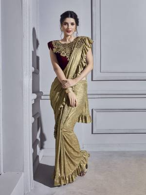 Get Ready For The Upcoming Wedding Season With This Designer Ready To Wear Saree In Golden Color Paired With Royal Maroon Colored Blouse. This Saree And Blouse Are Fabricated On Fancy Fabric Beautified  With Hand Work Over Blouse And Patch Work.