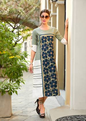 Pretty Elegant Looking Readymade Kurti Is Here In Light Green And White Color Fabricated On Poly Linen Fabric. It Is Beautified With Bold Floral Prints  andAlsi It Is Light Weight And Easy To Carry All Day Long.