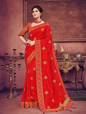 Wear this red color two tone silk fabrics saree. Ideal for party, festive & social gatherings. this gorgeous saree featuring a beautiful mix of designs. Its attractive color and heavy designer embroidered saree, paper mirror design, stone design, beautiful floral design all over work over the attire & contrast hemline adds to the look. Comes along with a contrast unstitched blouse.