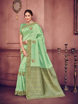 marvelously charming is what you will look at the next wedding gala wearing this beautiful Light green color two tone silk fabrics saree. Ideal for party, festive & social gatherings. this gorgeous saree featuring a beautiful mix of designs. Its attractive color and heavy designer embroidered saree, patch design, stone design, beautiful floral design all over work over the attire & contrast hemline adds to the look. Comes along with a contrast unstitched blouse.