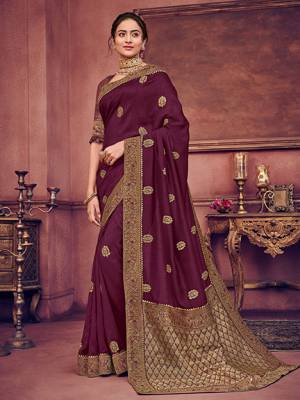 Bring out the best in you when wearing this Wine color two tone silk fabrics saree. Ideal for party, festive & social gatherings. this gorgeous saree featuring a beautiful mix of designs. Its attractive color and heavy designer embroidered saree, gotta design, stone design, beautiful floral design all over work over the attire & contrast hemline adds to the look. Comes along with a contrast unstitched blouse.