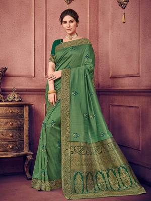 Vibrant and visually appealing, this green color two tone silk fabrics saree. Ideal for party, festive & social gatherings. this gorgeous saree featuring a beautiful mix of designs. Its attractive color and heavy designer embroidered saree, sequence design, stone design, beautiful floral design all over work over the attire & contrast hemline adds to the look. Comes along with a contrast unstitched blouse.