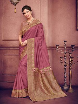 Look your ethnic best by wearing this Onion Pink color two tone silk fabrics saree. Ideal for party, festive & social gatherings. this gorgeous saree featuring a beautiful mix of designs. Its attractive color and heavy designer embroidered saree, patch design, stone design, beautiful floral design all over work over the attire & contrast hemline adds to the look. Comes along with a contrast unstitched blouse.