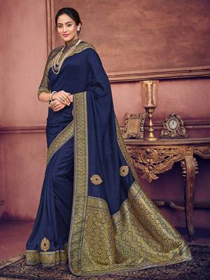 Look gorgeous in this beautiful printed Navy Blue color two tone silk fabrics saree. Ideal for party, festive & social gatherings. this gorgeous saree featuring a beautiful mix of designs. Its attractive color and heavy designer embroidered saree, patch design, beautiful floral design all over work over the attire & contrast hemline adds to the look. Comes along with a contrast unstitched blouse.