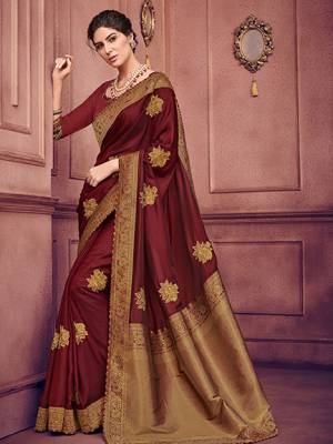 The fabulous pattern makes this saree a classy number to be included in your wardrobe. maroon color two tone silk fabrics saree. Ideal for party, festive & social gatherings. this gorgeous saree featuring a beautiful mix of designs. Its attractive color and heavy designer embroidered saree, patch design, beautiful floral design all over work over the attire & contrast hemline adds to the look. Comes along with a contrast unstitched blouse.