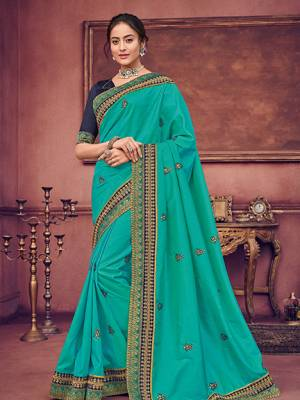 You Look elegant and stylish this festive season by draping this Blue color two tone silk fabrics saree. Ideal for party, festive & social gatherings. this gorgeous saree featuring a beautiful mix of designs. Its attractive color and heavy designer embroidered saree, sequence design, beautiful floral design all over work over the attire & contrast hemline adds to the look. Comes along with a contrast unstitched blouse.