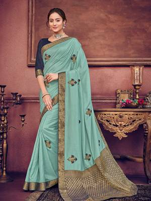 Wear this Aqua Blue color two tone silk fabrics saree. Ideal for party, festive & social gatherings. this gorgeous saree featuring a beautiful mix of designs. Its attractive color and heavy designer embroidered saree, patch design, beautiful floral design all over work over the attire & contrast hemline adds to the look. Comes along with a contrast unstitched blouse.