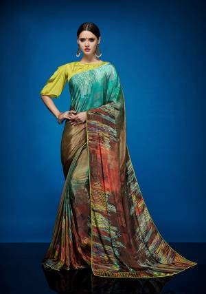 Rich And Elegant Looking Designer Printed Saree Is Here Fabricated On Crepe Silk Paired With Crepe Silk Fabricated Blouse. It Is Beautified With Abstract Prints All Over It.