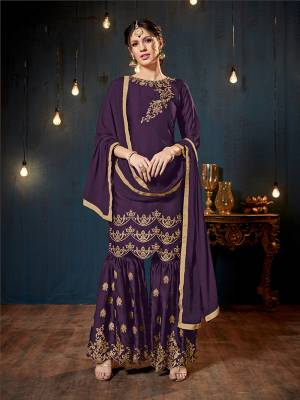 Get Ready For The Upcoming Festive And Wedding Season With This Heavy Designer Sharara Suit In Purple Color. Its Top And Bottom Are Fabricated On Satin Georgette Paired With Chiffon Fabricated Dupatta. It Is Beautified Heavy Embroidery Over The Top And Bottom Both.