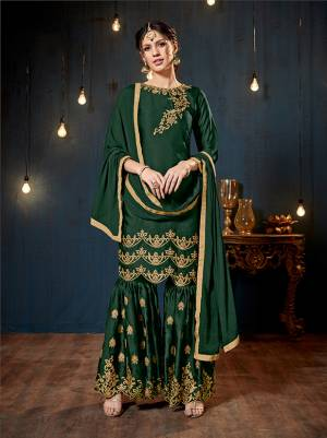 Get Ready For The Upcoming Festive And Wedding Season With This Heavy Designer Sharara Suit In Dark Green Color. Its Top And Bottom Are Fabricated On Satin Georgette Paired With Chiffon Fabricated Dupatta. It Is Beautified Heavy Embroidery Over The Top And Bottom Both.