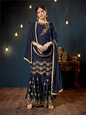 Get Ready For The Upcoming Festive And Wedding Season With This Heavy Designer Sharara Suit In Navy Blue Color. Its Top And Bottom Are Fabricated On Satin Georgette Paired With Chiffon Fabricated Dupatta. It Is Beautified Heavy Embroidery Over The Top And Bottom Both.