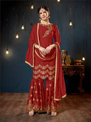 Get Ready For The Upcoming Festive And Wedding Season With This Heavy Designer Sharara Suit In Red Color. Its Top And Bottom Are Fabricated On Satin Georgette Paired With Chiffon Fabricated Dupatta. It Is Beautified Heavy Embroidery Over The Top And Bottom Both.