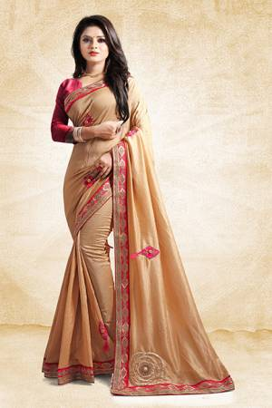 Here Is A Rich And Elegant Looking Designer Saree In Beige Color Paired With Contrasting Dark Pink Colored Blouse. This Saree And Blouse Are Silk Based With A Very Pretty Color Pallete Which Earn You Lots Of Compliments From Onlookers.