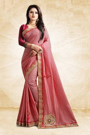 Here Is A Rich And Elegant Looking Designer Saree In Pink Color Paired With Contrasting Dark Pink Colored Blouse. This Saree And Blouse Are Silk Based With A Very Pretty Color Pallete Which Earn You Lots Of Compliments From Onlookers.