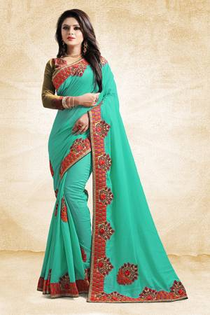Add This Pretty Designer Saree To Your Wardrobe In Sea Green Color Paired With Golden Colored Blouse. This Saree And Blouse Are Silk Based Beautified With Heavy Embroidered Lace Border. Buy Now.