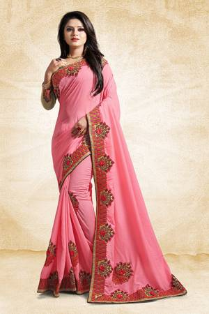 Add This Pretty Designer Saree To Your Wardrobe In Pink Color Paired With Golden Colored Blouse. This Saree And Blouse Are Silk Based Beautified With Heavy Embroidered Lace Border. Buy Now.