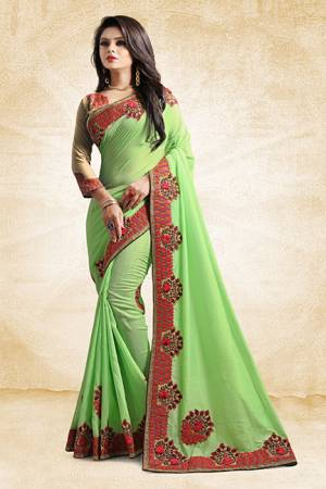 Add This Pretty Designer Saree To Your Wardrobe In Green Color Paired With Golden Colored Blouse. This Saree And Blouse Are Silk Based Beautified With Heavy Embroidered Lace Border. Buy Now.