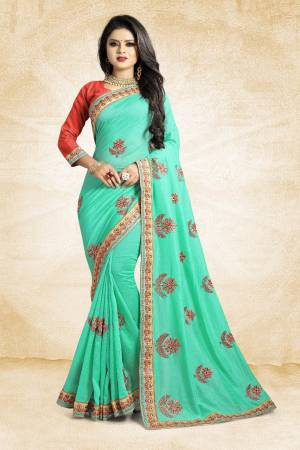 Celebrate This Festive Season With Colorful Attire. Grab This Designer Saree In Sea Green Color Paired With Contrasting Red Colored Blouse. This Saree And Blouse Are Rich Silk Based Beautified Embroidery All Over. Buy Now.