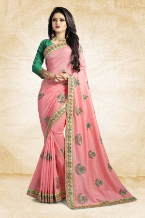 Celebrate This Festive Season With Colorful Attire. Grab This Designer Saree In Pink Color Paired With Contrasting Green Colored Blouse. This Saree And Blouse Are Rich Silk Based Beautified Embroidery All Over. Buy Now.