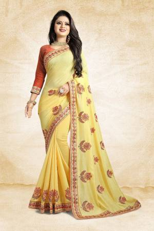 Celebrate This Festive Season With Colorful Attire. Grab This Designer Saree In Yellow Color Paired With Contrasting Orange Colored Blouse. This Saree And Blouse Are Rich Silk Based Beautified Embroidery All Over. Buy Now.
