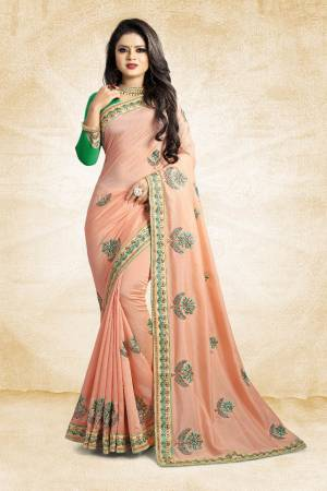 Celebrate This Festive Season With Colorful Attire. Grab This Designer Saree In Light Peach Color Paired With Contrasting Green Colored Blouse. This Saree And Blouse Are Rich Silk Based Beautified Embroidery All Over. Buy Now.