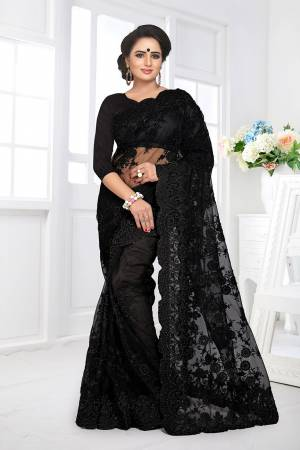 Here Is A Beautiful Heavy Designer Net Fabricated Saree And Blouse. This Saree And Blouse Are Beautified With Heavy Resham Embroidery All Over With Ceramic Stone Work. This Pretty Saree Comes With A Matching Satin Fabricated Inner. Buy This Heavy Designer Saree Now.