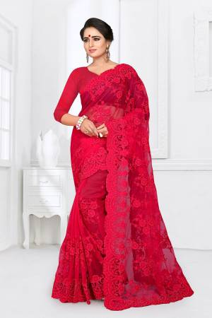 If You Are Fond Of Tone On Tone Embroidery, than This Designer Saree In Perfect For Your. This Heavy Saree And Blouse Are Fabricated On Net Beautified With Tone To Tone Heavy Resham Embroidery With Ceramic Stone Work All Over It. Buy This Saree Now.