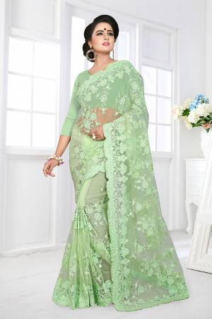 For A Rich, Heavy And Elegant Look, This Heavy Designer Saree Is Perfectly Suitable For All. This Saree And Blouse are Fabricated On Net Beautified With Heavy Resham Embroidery And Ceramic Stone Work.