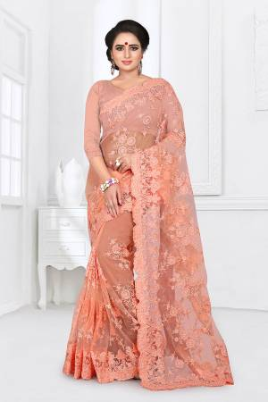 You Will Definitely Earn Lots Of Compliments Wearing This Heavy Designer Saree. This Saree And Blouse Are Fabricated On Net Beautified With Heavy Resham Embroidery With Ceramic Stone Work All Over It.
