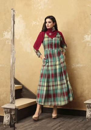 Grab This Pretty Checks Printed Readymade Designer Kurti In Multi Color Paired With A Very Pretty Maroon Colored Embroidered Scarf. This Kurti Is Fabricated O Muslin Paired With Rayon Fabricated Scarf. Buy Now.