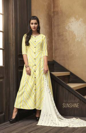 This Festive Season, Celebrate With Beauty And Comfort Wearing This Readymade Kurti In Yellow Color Paired With A Very Pretty White Colored Embroidered Scarf. This Printed Kurti Is Fabricated On Muslin Paired With Rayon Fabricated Scarf. Buy Now.