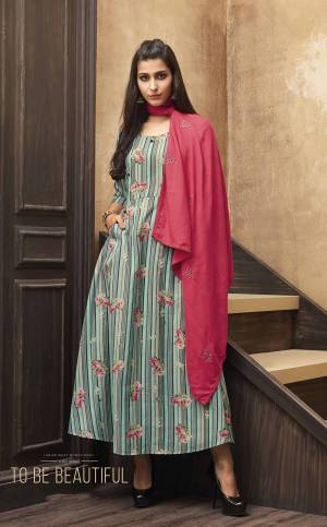 Floral Prints Can Never Go Out Of Trend, So Grab This Readymade Kurti In Sea Green Color Paired With Contrasting Crimson Red Colored Scarf. This Kurti IS Fabricated On Muslin Beautified With Lining And Floral Prints Paired With Embroidered Rayon Fabricated Scarf.