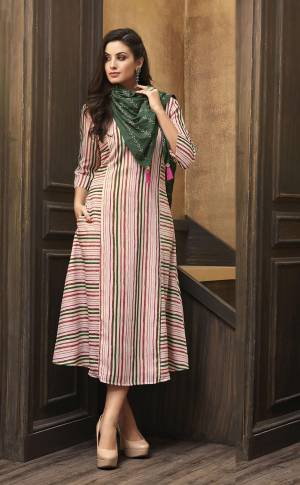 Look Pretty In this Readymade Kurti In Pink Color Paired With Contrasting Dark Green Colored Scarf. This Pretty Kurti Is Fabricated On Muslin Beautified With Lining Prints All Over Paired With Rayon Fabricated Embroidered Scarf.