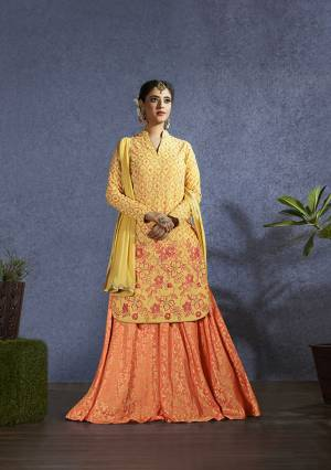 Celebrate This Festive Season With Some New Designer Pattern With This Designer Lehenga Suit In Yellow Colored Top And Dupatta Paired With Orange Colored Lehenga. Its Top Is Fabricated On Muslin Paired With Jacquard Silk Lehenga And Chiffon Dupatta.