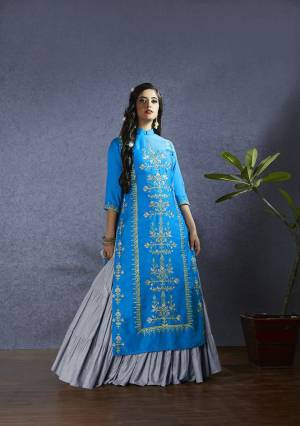 New Color Pallete Is Here With This Designer Lehenga Suit In Blue Colored Top And Dupatta Paired With Grey Colored Lehenga. Its Top IS Fabricated On Satin Paired With Muslin Lehenga And Chiffon Based Dupatta. All Its Fabric Ensures Superb Comfort All Day Long.