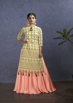 Rich And Elegant Looking Designer Lehenga Suit Is Here In Beige Colored Top Paired With Very Pretty Peach Colored Lehenga And Dupatta. Its Top Is Fabricated On Chanderi Paired With Satin Georgette Lehenga And Chiffon Fabricated Dupatta. Buy This Designer Piece Now.
