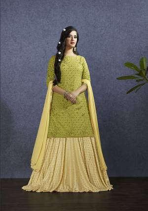 Pretty Shades Are Here With This Designer Lehenga Suit In Pear Green Colored Top Paired With Light Yellow Colored Lehenga And Dupatta. Its Top Is Fabricated On Muslin Paired With Nylon Jacquard Lehenga And Chiffon Fabricated Dupatta. Buy Now.