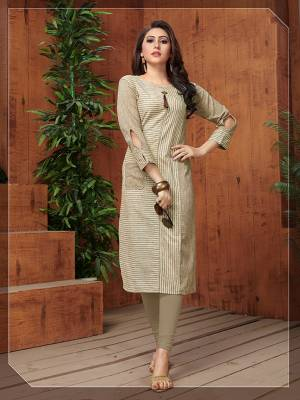 Flaunt Your Rich And Elegant Taste In This Rich Looking Readymade Kurti In Beige Color Fabricated On Khadi Cotton. It Is Beautified With Lining Prints Which Is Giving An Elegant Look Overall.