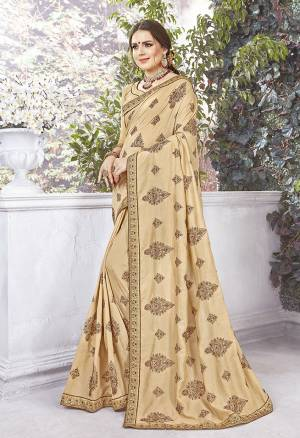 Rich And Elegant Looking Designer Saree Is Here In Beige Color Paired With Beige Colored Blouse. This Saree And Blouse are Silk fabricated Beautified With Thread Embroidery And stone Work .It Is Light Weight And Easy To carry All Day Long.