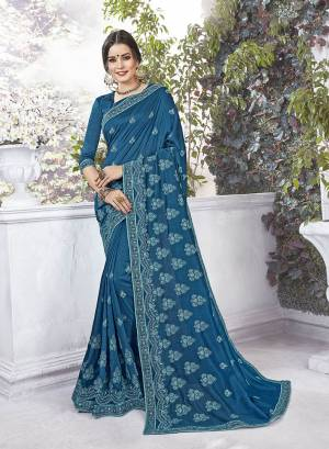 Celebrate This Festive Season Wearing This Designer Silk Based Saree In Blue Color Paired With Blue Colored Blouse. This Saree And Blouse Are Silk Based Beautified With Thread Embroidery And Stone Work .