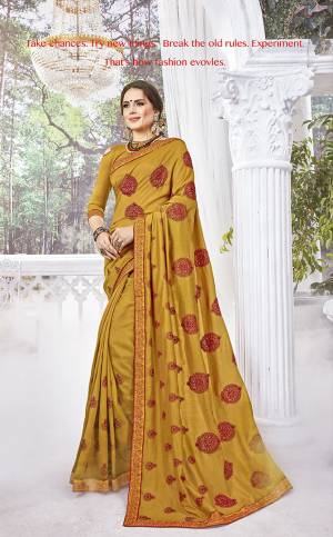 Shine Bright In This Designer Musturd Yellow Colored Saree Paired With Musturd Yellow Colored Blouse. This Saree And Blouse Are Silk Based Beautified With Contrasting Thread Embroidery And Stone Work.