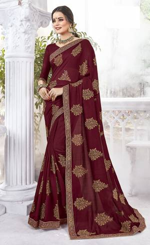Rich And Elegant Looking Designer Saree Is Here In Maroon Color Paired With Maroon Colored Blouse. This Saree And Blouse are Silk fabricated Beautified With Thread Embroidery And stone Work .It Is Light Weight And Easy To carry All Day Long.