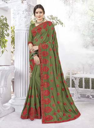 Look Beautiful Wearing This Designer Saree In Olive Green Color Paired With Oliev Green Colored Blouse. This Saree And Blouse Are Fabricated Vichitra Silk And Art Silk Respectively. It Is Easy To Drape, Durable And Easy To Care For.