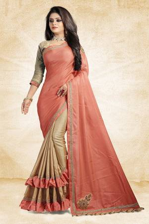 For A Rich And Elegant Look, Grab This Designer Saree In Peach And Beige Color Paired With Beige Colored Blouse. This Saree And Blouse Are Silk Based Beautified with Embroidered Patch Work And Lace Border. Buy Now.