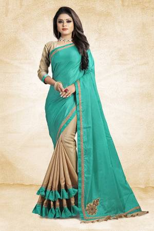 For A Rich And Elegant Look, Grab This Designer Saree In Blue And Beige Color Paired With Beige Colored Blouse. This Saree And Blouse Are Silk Based Beautified with Embroidered Patch Work And Lace Border. Buy Now.