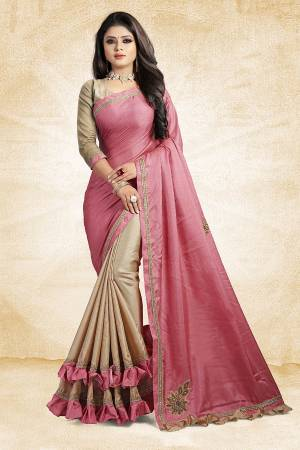 For A Rich And Elegant Look, Grab This Designer Saree In Pink And Beige Color Paired With Beige Colored Blouse. This Saree And Blouse Are Silk Based Beautified with Embroidered Patch Work And Lace Border. Buy Now.