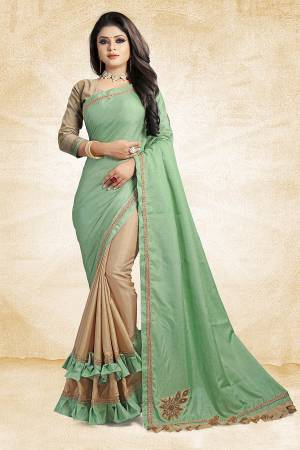For A Rich And Elegant Look, Grab This Designer Saree In Light Green And Beige Color Paired With Beige Colored Blouse. This Saree And Blouse Are Silk Based Beautified with Embroidered Patch Work And Lace Border. Buy Now.